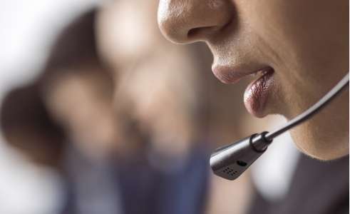 Telephone headset on person close-up
