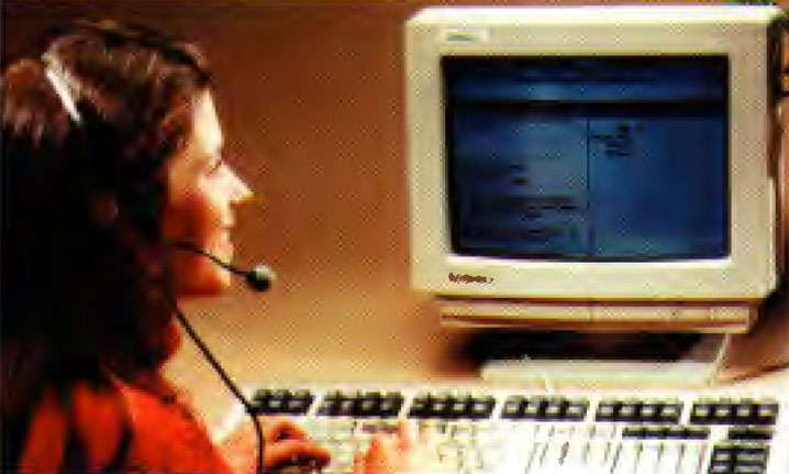 Woman wearing headset in front of computer